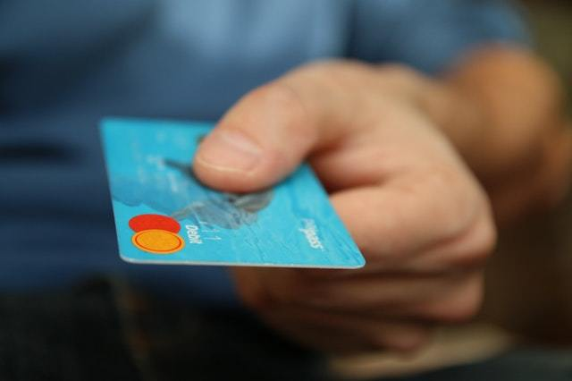 State of course creation - A hand holding a debit card