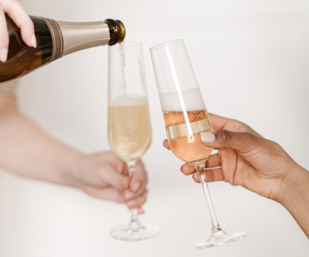virtual event: pouring out champagne into glasses