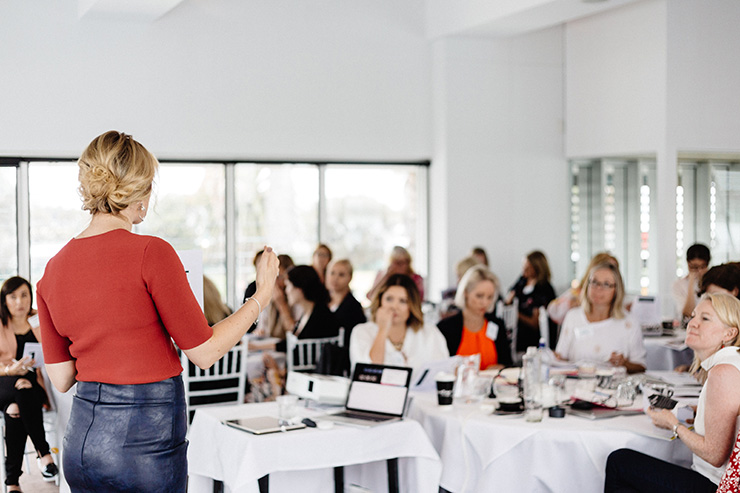 one page website: Grace Lever teaching her class of female entrepreneurs