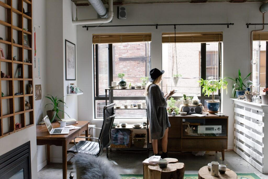 A woman standing in her home office