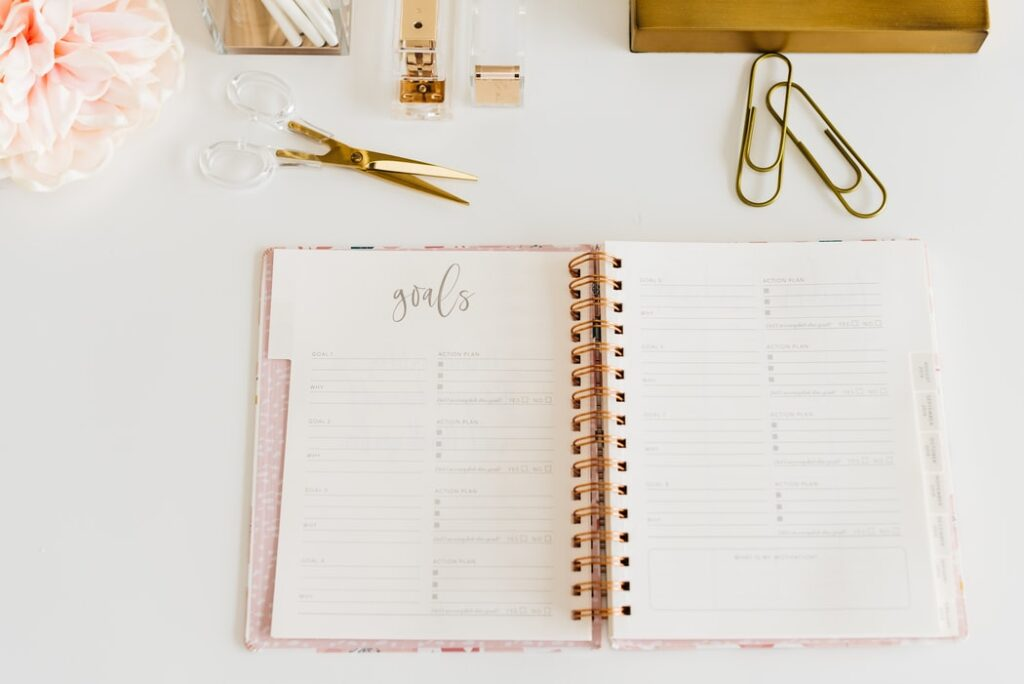 A notepad and office supplies arranged on a white table
